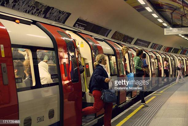 CONTENT] Passengers are disembarking a Central LIne train in London Tube