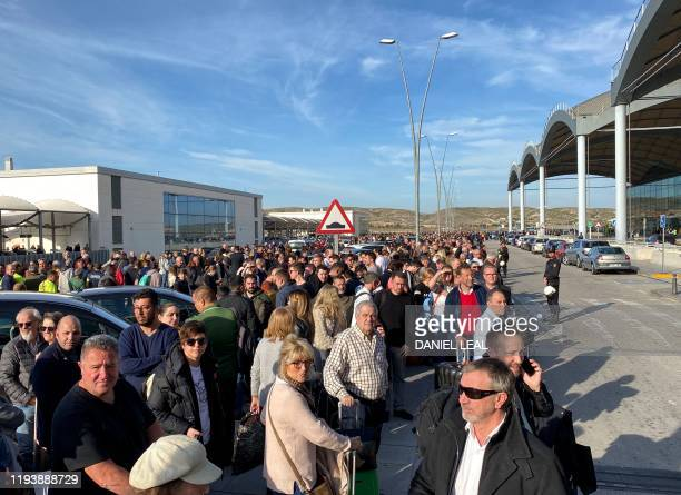 Passengers are evacuated at AlicanteElche airport on January 15 2020 in Alicante after a fire erupted in the terminal