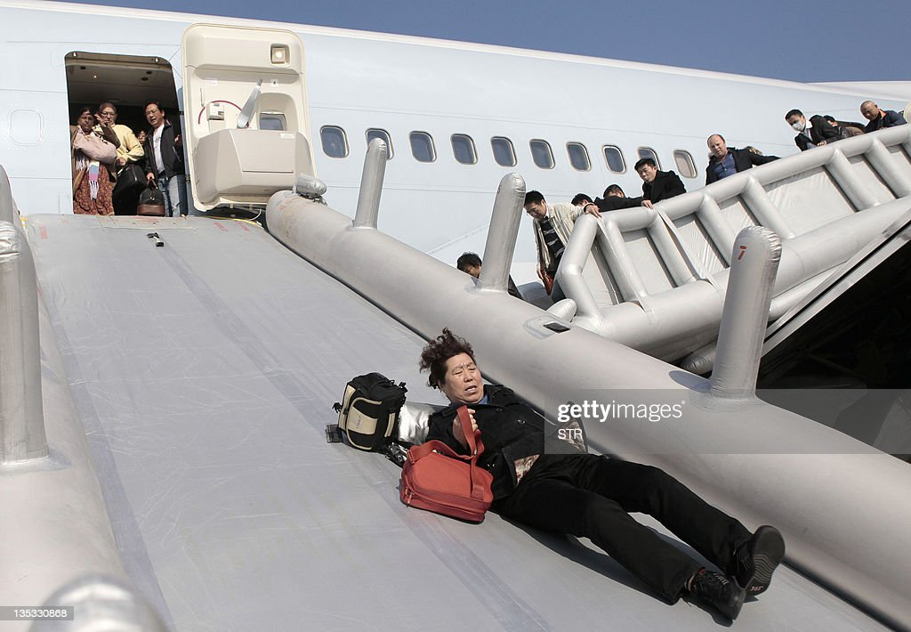 Passengers are evacuated from a Cathay P : News Photo