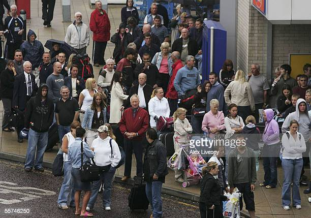 Passengers are evacuated from Terminal 1 as Manchester Airport is cordoned off after an incident between Terminals 1 and 2, on September 23, 2005 in...