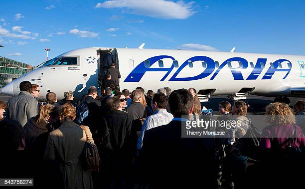 Passengers are going into a Bombardier CRJ900 from Adria in Ljubljana airport The Slovenian national airline Adria Airways has a wealth of experience...