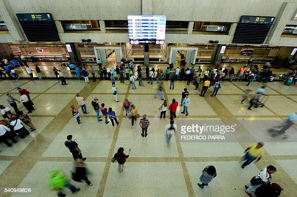 Passengers are pictured at Simon Bolivar international airport in Caracas on June 17 2016 German airline Lufthansa suspended flights to crisishit...