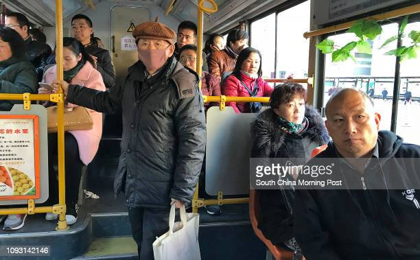 Passengers are pictured on a bus in street in Baotou city, Inner Mongolia, on Nov. 17, 2017. The metro construction in Baotou city has been suspended...