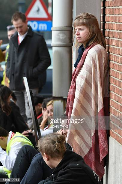 Passengers are pictured on March 22 2016 near Brussels airport in Zaventem following its evacuation after at least 13 people were killed and 35...