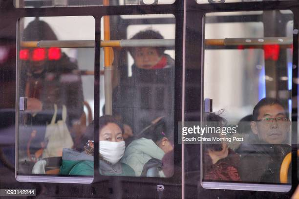 Passengers are pictured taking ride in a bus in street in Baotou city, Inner Mongolia, on Nov. 17, 2017. The metro construction in Baotou city has...
