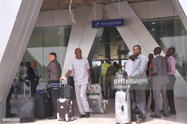 Passengers are seen after arriving from Addis Ababa, at Kaduna's airport, on March 8, 2017. Nigeria's capital was cut off by air today, as Abuja...
