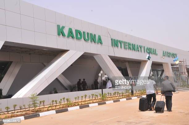 Passengers are seen after arriving from Addis Ababa at Kaduna's airport on March 8 2017 Nigeria's capital was cut off by air today as Abuja airport...