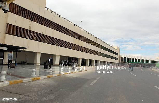 Passengers are seen at Baghdad's international airport on October 21 2014 Iraqi Airways are continuing their daily flights between Basra and Baghdad...