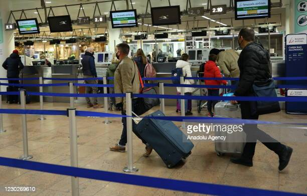 Passengers are seen at Brussels Airport as flights to UK begin again after Belgium temporarily banned air and rail links to UK for 48 hours due to...