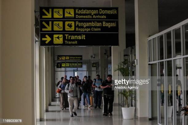Passengers are seen at Sultan Syarif Kasim II Airport in Pekanbaru Riau Indonesia on September 19 2019 Visibility limited to 500 meters because of...