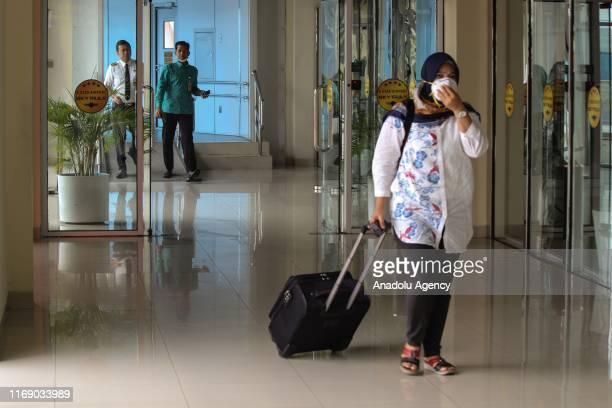 Passengers are seen at Sultan Syarif Kasim II airport in Pekanbaru Riau Indonesia on September 18 2019 Visibility limited to 500 meters because of...