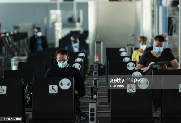 Passengers are seen at the boarding gate with protective face mask, Brussels Airport resumes its passenger activities today In Zaventem - Belgium on...