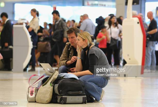 Passengers are seen at the Qantas check in terminal on October 29 2011 in Melbourne Australia Qantas CEO Alan Joyce announced at a press conference...