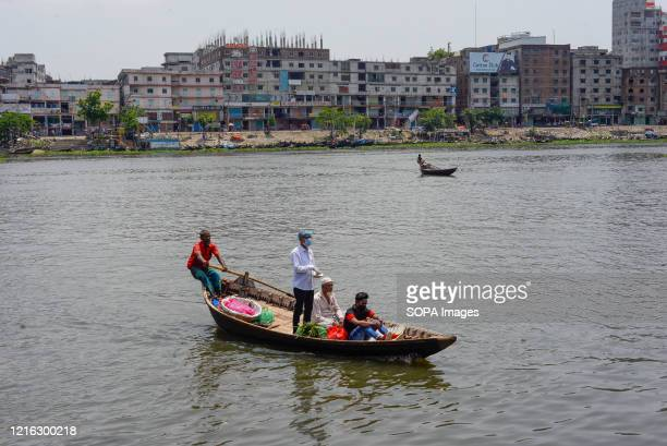 Passengers are seen crossing the river by boat as the boat terminal reopens after the Coronavirus lockdown crisis. Bangladesh government is likely to...