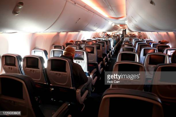 Passengers are seen in a cabin midflight on a Baltimore Maryland bound Delta flight from HartsfieldJackson Atlanta International Airport on April 20...