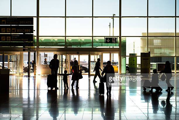 Passengers are seen in the departure hall at Aena operated Barcelona El Prat International Airport on February 10 2015 in Barcelona Spain Shares in...