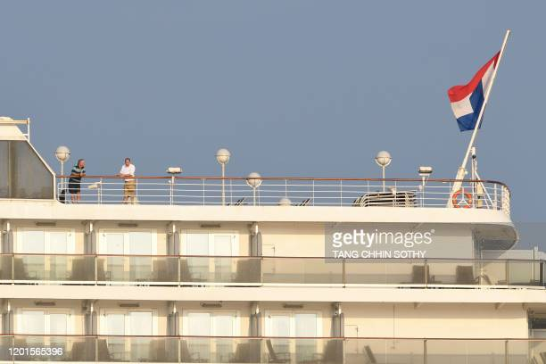 Passengers are seen on board the Westerdam cruise ship in Sihanoukville on February 18 where the liner on February 13 docked after being refused...