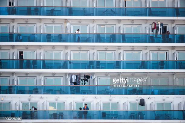 TOPSHOT Passengers are seen on the balconies of the Diamond Princess cruise ship with around 3600 people quarantined onboard due to fears of the new...