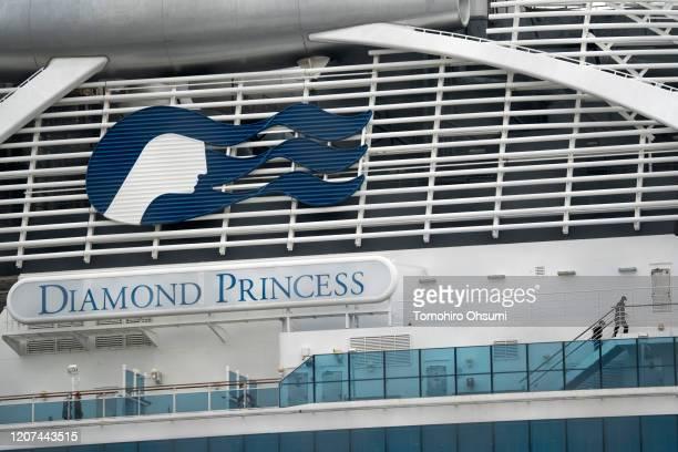 Passengers are seen on the deck of the quarantined Diamond Princess cruise ship docked at the Daikoku Pier on February 20 2020 in Yokohama Japan...