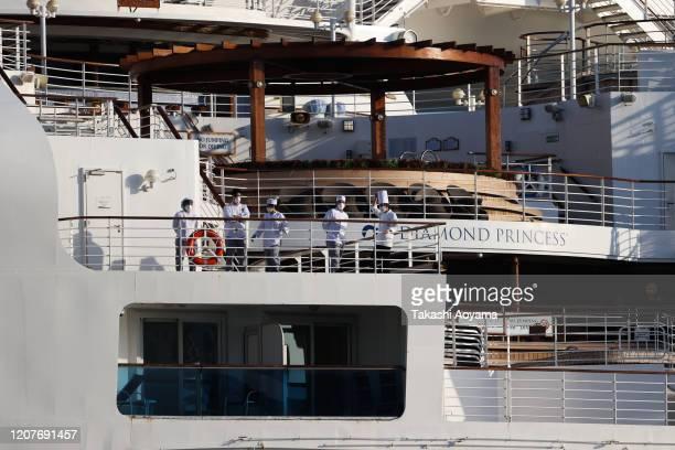 Passengers are seen on the quarantined Diamond Princess cruise ship at the Daikoku Pier on February 21 2020 in Yokohama Japan Passengers who have...