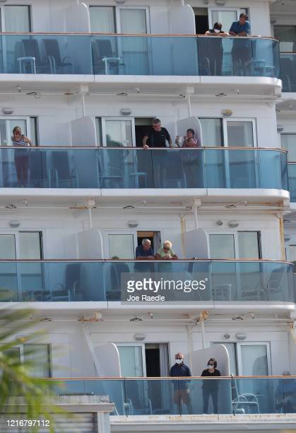 Passengers are seen on their balconies of the cruise ship Coral Princess after it docked at Port Miami on April 04 2020 in Miami Florida Reports...