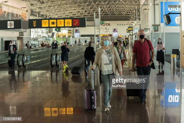 Passengers are seen on there way to the boarding gate, Brussels Airport resumes its passenger activities today In Zaventem - Belgium on 15 June 2020....