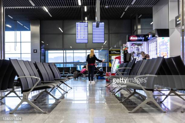 Passengers are seen waiting at nearly empty Krakow Airport as many International flights are canceled due to ongoing Covid-19 pandemic and national...