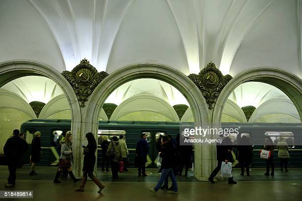 Passengers are seen walking past at the Paveletskaya Metro Station in Moscow Russia on April 01 2016 The Moscow Metro was one of USSRs most ambitious...