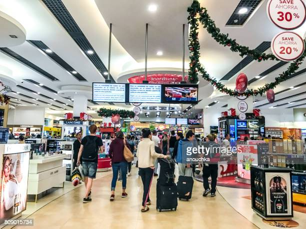 passengers are shopping in duty free shops in cancun international airport, mexico - mexican christmas stock photos and pictures