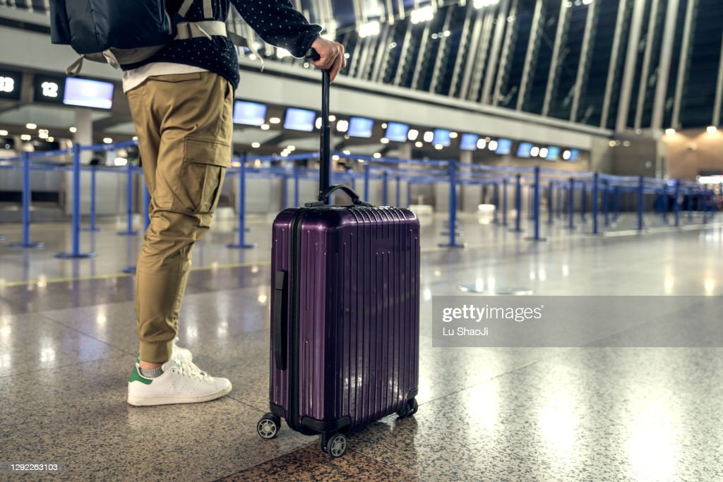 Passengers are waiting at the airport terminal. : Stock Photo