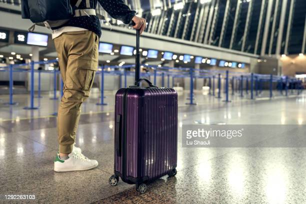 passengers are waiting at the airport terminal. - recessed lighting stock pictures, royalty-free photos & images