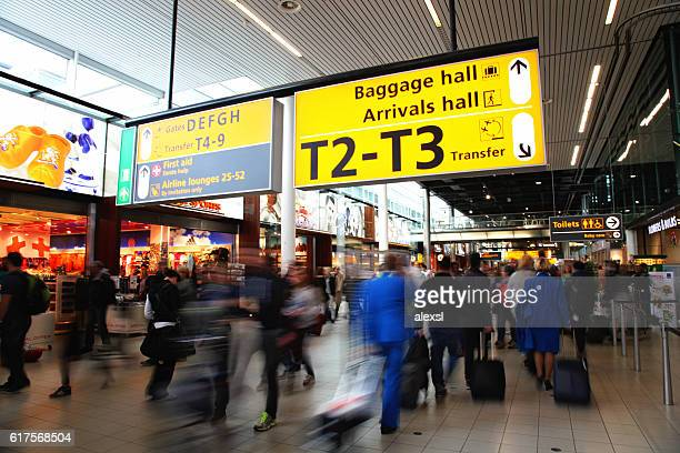Passengers are walking in Amsterdam Airport Schiphol, Netherland