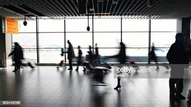 Passengers are walking in Amsterdam Airport Schiphol, Netherlands