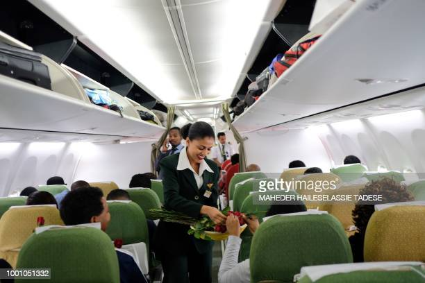 Passengers are welcomed by cabin crew inside an Ethiopian Airlines flight who departed from the Bole International Airport in Addis Ababa Ethiopia to...
