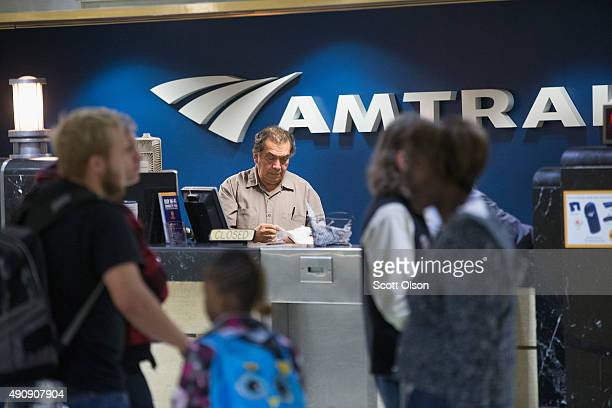 Passengers arrive at Amtrak's Union Station to catch trains on October 1 2015 in Chicago Illinois Amtrak announced it will begin charging a $20...