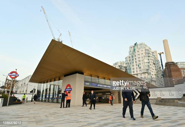 Passengers arrive at Battersea Power station as the new northern line London underground extension opens to the public in London on September 20,...