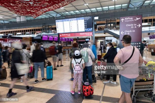 Passengers arrive at Berlin Brandenburg Airport on July 01, 2021 in Schoenefeld, Germany. Germany is removing pandemic-related travel warnings for...