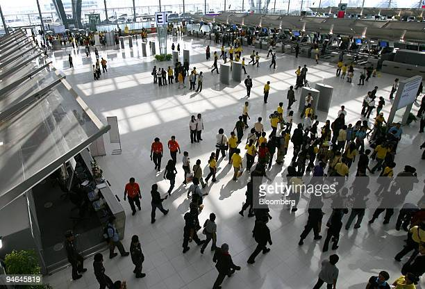 Passengers arrive at Don Muang Airport ahead of the first commercial test flight from the old airport to the new Suvarnabhumi Airport in Bangkok...