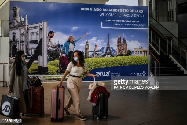 Passengers arrive at Faro airport in Algarve, south of Portugal, on May 17, 2021. - British holidaymakers arrived in Portugal as the country hopes to...
