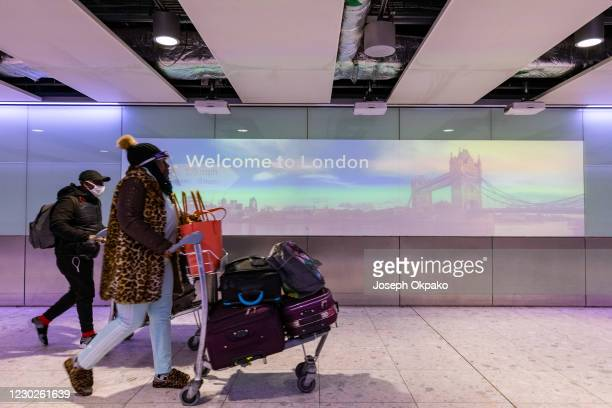 Passengers arrive at Heathrow Airport days after new lockdown restictions came into place on December 22, 2020 in London, England. London and the...