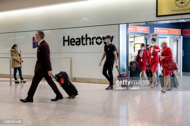 Passengers arrive at Heathrow Airport just in time for Christmas in a few days on December 22, 2020 in London, England. London and the South East...