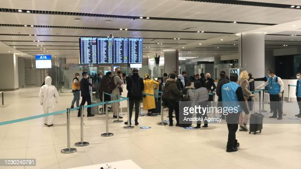 Passengers arrive at Istanbul airport as Turkey began testing passengers arriving from the UK early Monday for a new variant of the coronavirus after...