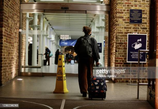 Passengers arrive at St Pancras International train station in London, United Kingdom on December 20, 2020 as several European countries ban travel...