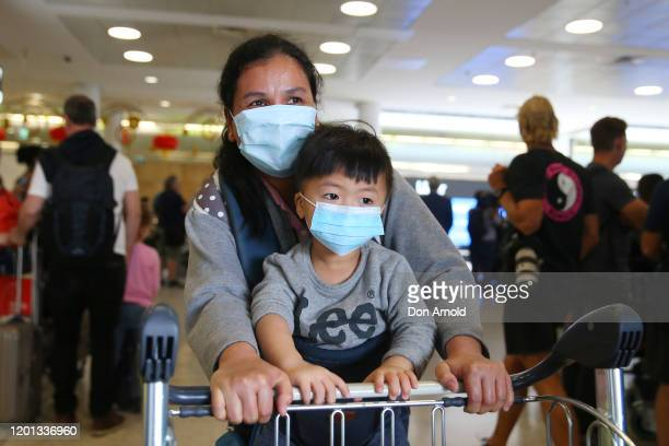 Passengers arrive at Sydney International Airport on January 23 2020 in Sydney Australia Among arrivals were passengers of a flight from Wuhan which...