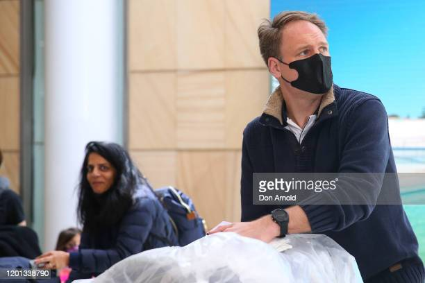 Passengers arrive at Sydney International Airport on January 23, 2020 in Sydney, Australia. Among arrivals were passengers of a flight from Wuhan,...