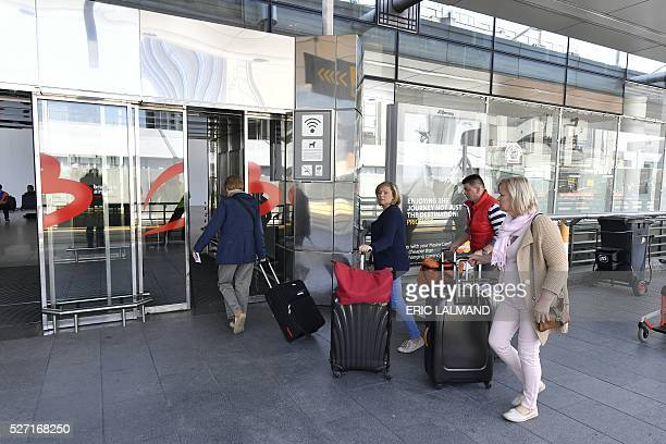 Passengers arrive at the departure hall at Brussels Airport on the first day of its partly reopening on May 2 2016 40 days after suicide attacks...