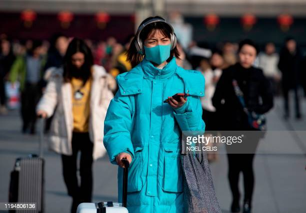Passengers arrive at the train station in Hanzhong a mountainous region of Shaanxi province on January 20 ahead of the Lunar New Year A mysterious...