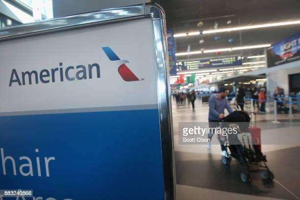 Passengers arrive for American Airlines flights at O'Hare International Airport on November 30 2017 in Chicago Illinois American Airlines was...