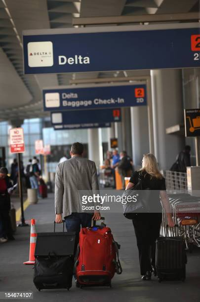 Passengers arrive for Delta Airlines flights at O'Hare International Airport on October 24 2012 in Chicago Illinois Delta Airlines Inc said its...
