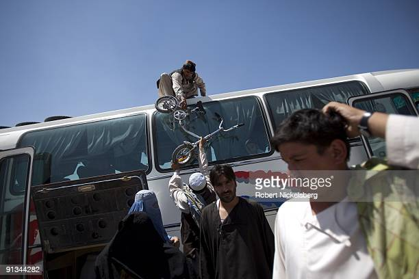 Passengers arrive in Kabul AfghanistanÕs bus terminal having traveled from the countryÕs southern provinces originating in Kandahar August 1 2009...